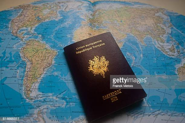 French passport on a world map
