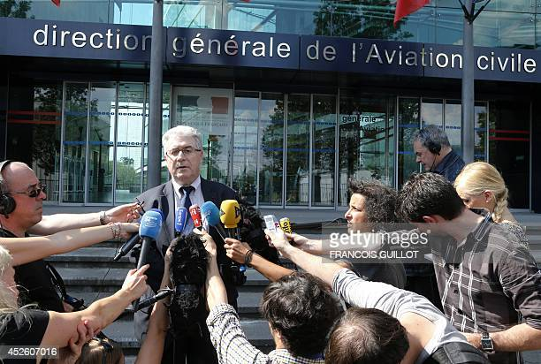 French Patrick Gandil, head of the Directorate General for Civil Aviation , answers to journalistson July 24, 2014 after a crisis meeting at the DGAC...