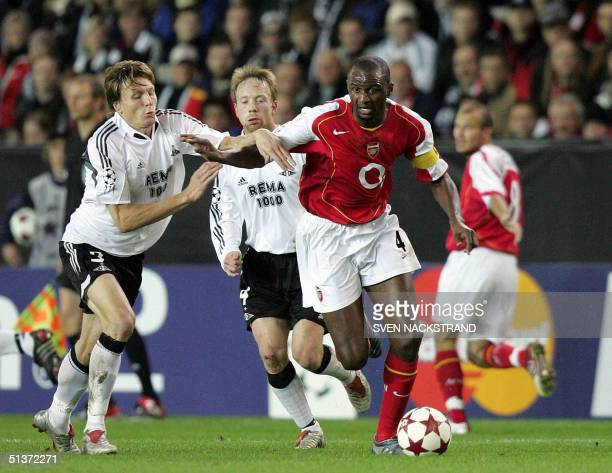 French Patrick Vieira of Arsenal is chased by Frode Johnsen and Fredrik Winsnes of Rosenborg goalkeeper Espen Johnsen in the Champions League group E...