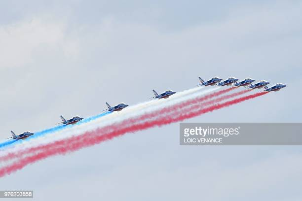 French patrol fly on Alpha jets prior to the start of the 86th edition of the 24h du Mans car endurance race on June 16 2018 in Le Mans western France