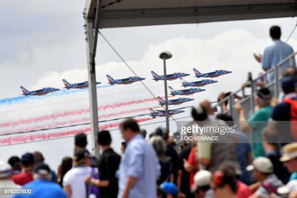 French patrol fly their alpha jets prior to the start of the 86th edition of the 24h du Mans car endurance race on June 16 2018 in Le Mans western...