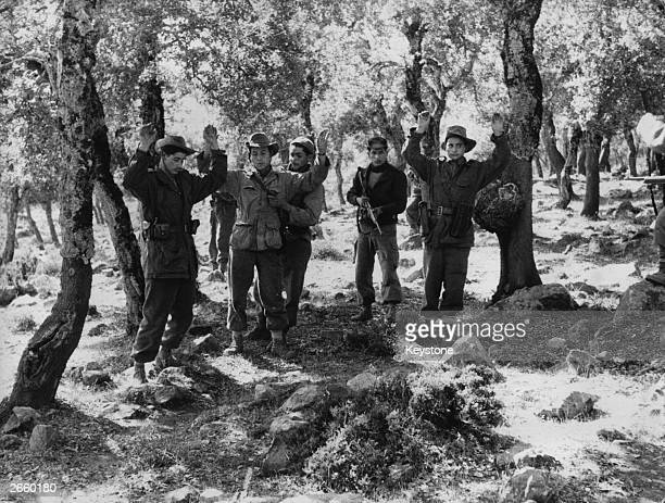 A French patrol standing with their hands up after being ambushed by Algerian rebels