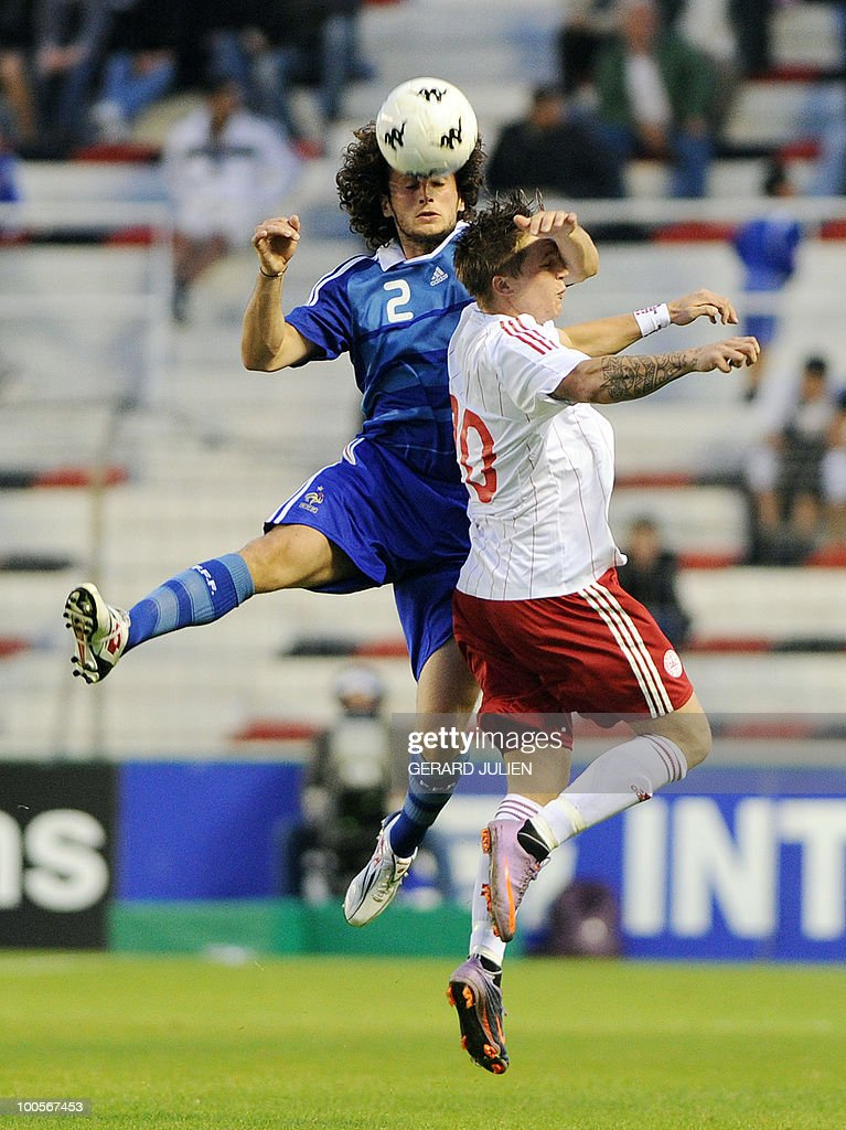 French Paul Baysse (L) vies with Danish Nicki Bille Nielsen (R) during their Under 21 International Tournament football match France versus Denmark on May 25, 2010 at the Mayol stadium in Toulon, southern France. This is the 38th edition of the event.