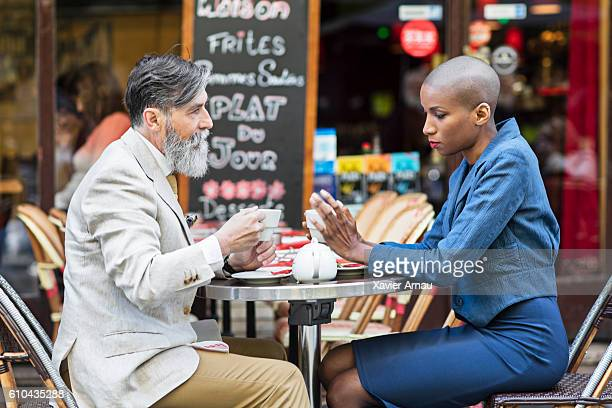 French people having coffee in a pavement cafe at Paris
