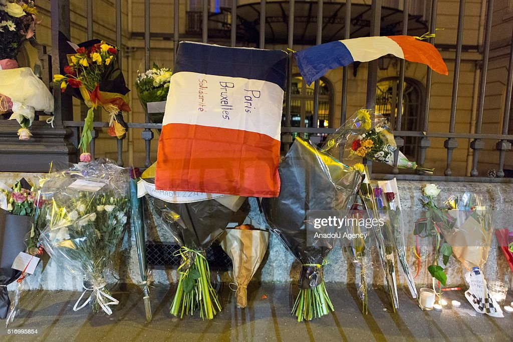 French people leave French flag and flowers to pay respect to Belgium after Brussels Terror attack, at the Belgian Embassy in Paris, France on March 22, 2016.