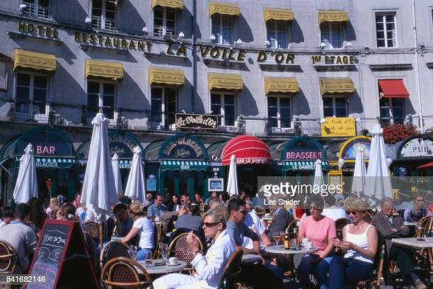 French People Sitting at Outdoor Cafe