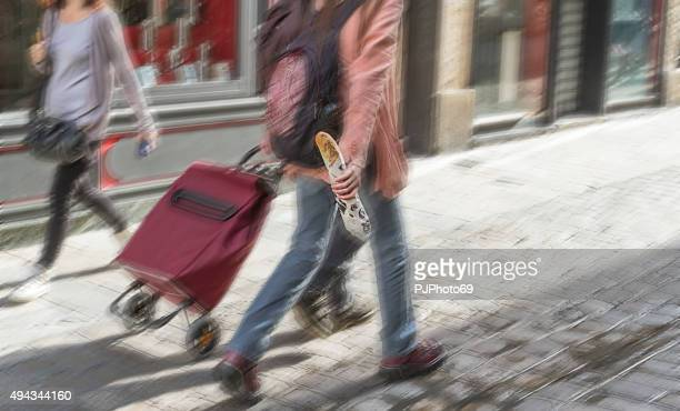 French people walking holding a baguette