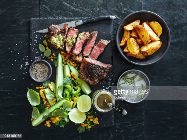 french pepper steak (steak au poivre) with fresh vegetables and herbs - salad stock pictures, royalty-free photos & images