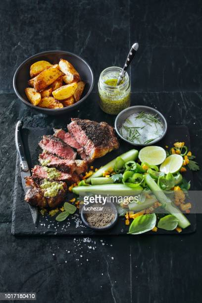 French pepper steak (Steak au Poivre) with fresh vegetables and herbs