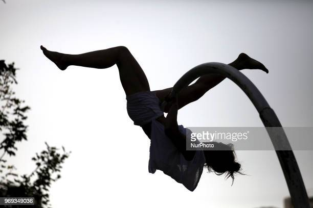 French performer Chloe Moglia delivers a breathtaking acrobatic performance at Syntagma square in Athens Greece on June 7 2018 as part of the Athens...