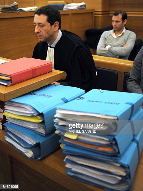 French Philippe Soussi lawyer of Anthony AshleyCooper's family 10th Earl of Shaftesbury is pictured behind the files on February 4 2009 at...