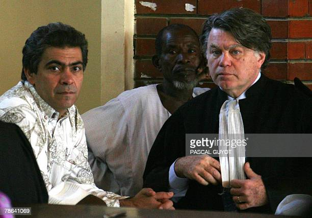 French Philippe Van Wilkelberg worker of the French charity Zoe's Ark and Sudanese Souleimane Ibrahim Adam stand next to their lawyer Gilbert Collard...