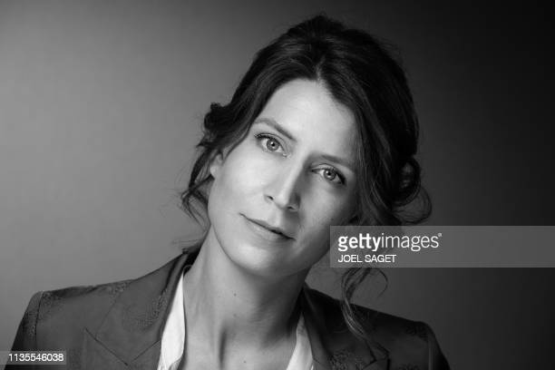 French philosopher Adele Van Reeth poses for a photo session during the 2nd edition of the Cannes International Series Festival in Cannes, southern...
