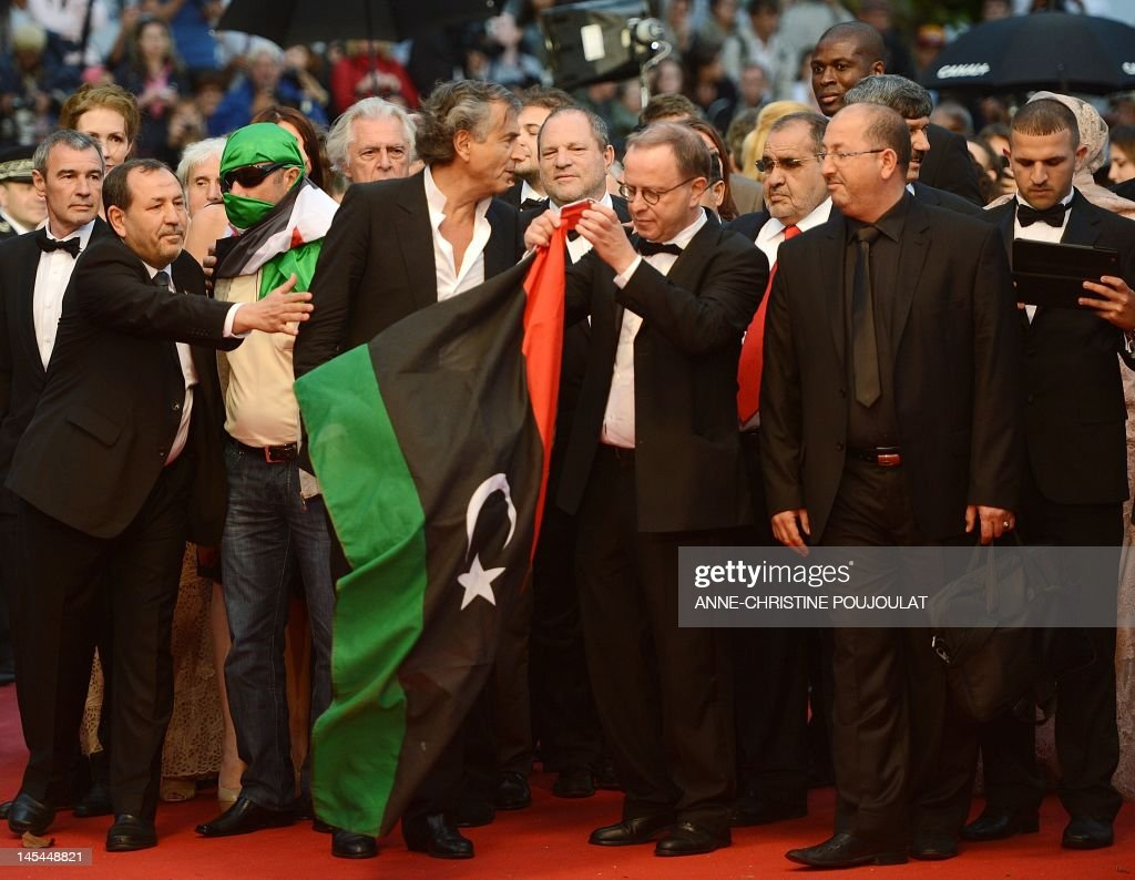 French philosopher and co-screenwriter Bernard-Henri Levi (C) arrives with the cast of his film 'Le Serment de Tobrouk' for the special screening at the 65th Cannes film festival on May 25, 2012 in Cannes. Background US producer Harvey Weinstein.