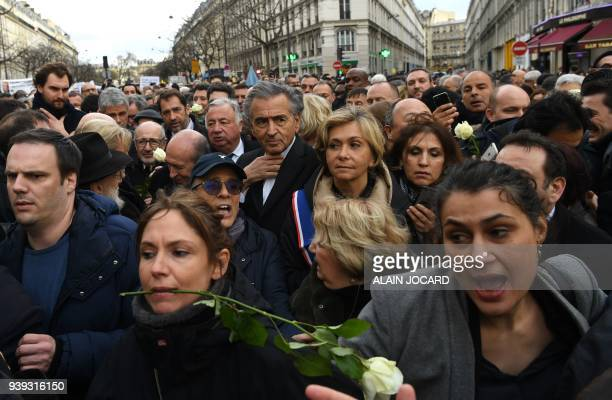 French philosopher BernardHenri Levy and Ile De France Region President Valerie Pecresse walk with others during a silent march in Paris on March 28...