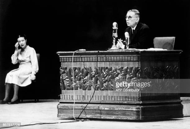 French philosopher JeanPaul Sartre speaks during a conference for japanese students as French writer Simone de Beauvoir looks on on September 27 1966...