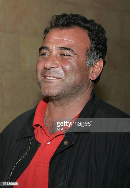 French photographer Alfred Yagohbzadeh smiles as he speaks to the press 15 March 2005 as they arrive to the French consult in Jerusalem after he and...