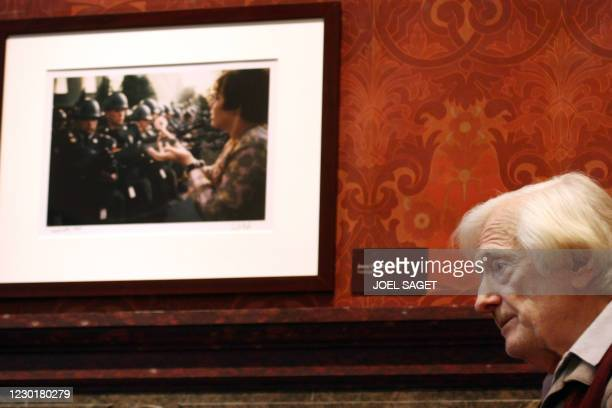 French photographer and reporter Marc Riboud stands in front of one of his picture at the Musee de la vie romantique/Musee Renan-Scheffer on March...
