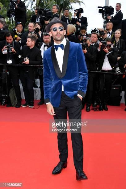 French photographer JR attends the screening of Les Miserables during the 72nd annual Cannes Film Festival on May 15 2019 in Cannes France