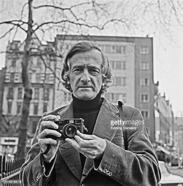 French photographer Marc Riboud on Leicester Square in London, UK, 12th March 1974.