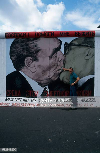 French photographer Regis Bossu in front of the Berlin wall portion named East Side Gallery He is the author of the famous picture showing Soviet...