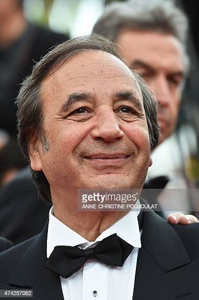 French photographer Richard Melloul poses as he arrives for the screening of the film Dheepan at the 68th Cannes Film Festival in Cannes southeastern...