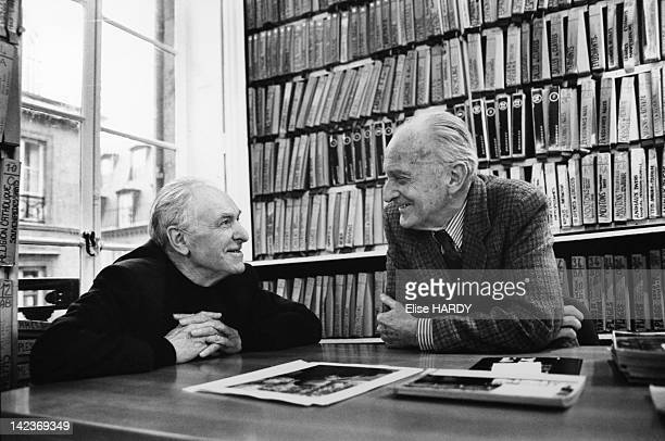 French photographer Robert Doisneau and Raymond Grosset director of Rapho Agency in the offices of the agency during the filming of 'Doisneau des...
