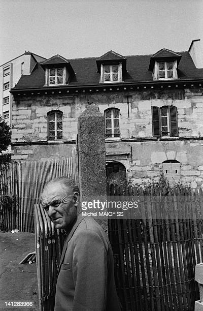 French photographer Robert Doisneau in front of his birth house in Gentilly on April 17 1989 in Gentilly France