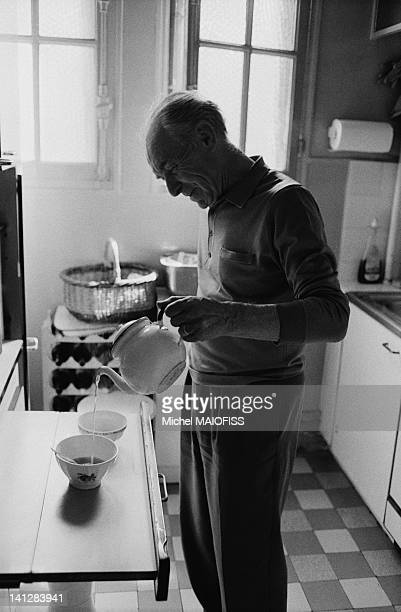 French photographer Robert Doisneau preparing hot beverage in his kitchen on June 18 1988 in Montrouge France