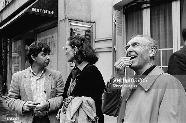 French photographer Robert Doisneau with photographers Christian Caujolle and Martine Franck at the opening of Picture Wall in the Odeon neighborhood...