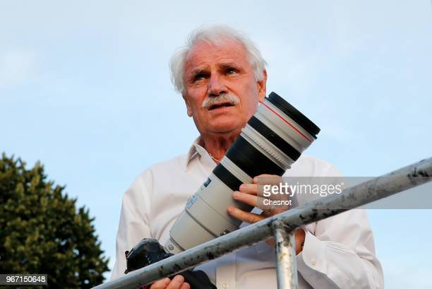 French photographer Yann Arthus Bertrand is seen during the 30th edition of the 'Diner En Blanc' event on the Invalides esplanade on June 3 2018 in...