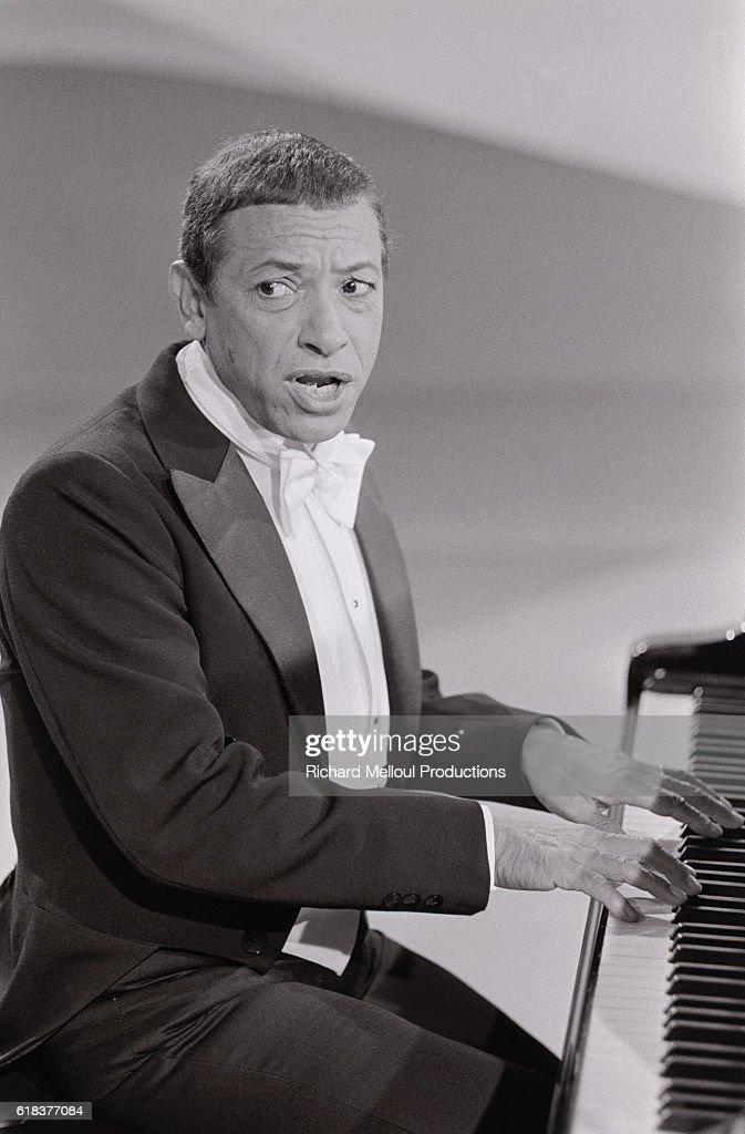 Singer Henri Salvador Plays Piano : News Photo