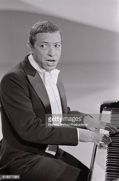 French pianist and singer Henri Salvador tapes a 1978 Christmas program. The show is being directed by Roger Pradines, and will feature as guests...