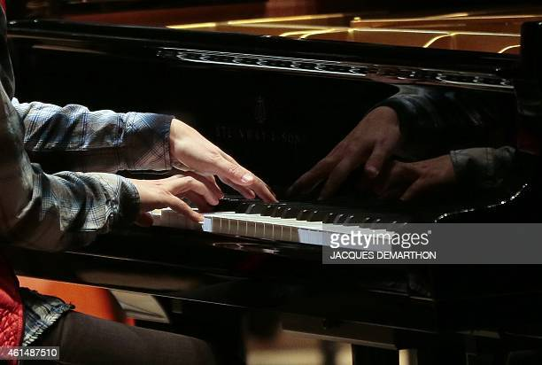 French pianist Helene Grimaud performs during a rehearsal at the new Philharmonie de Paris ahead of its opening in Paris on January 13 2015 The...