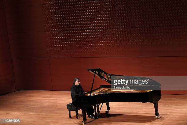 """French pianist Pierre-Laurent Aimard performing in """"The Liszt Project"""" at Alice Tully Hall on Sunday afternoon, April 22, 2012."""