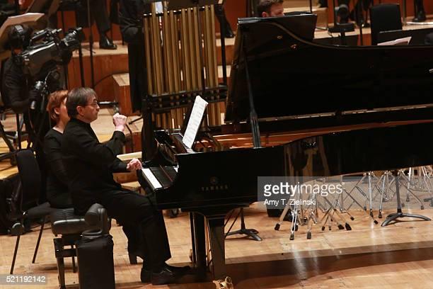 French pianist Pierre-Laurent Aimard performs composer Olivier Messiaen's 'Couleurs de la cite celeste' on the piano as British conductor Sir Simon...