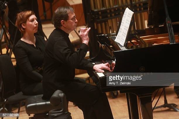 French pianist PierreLaurent Aimard performs composer Olivier Messiaen's 'Couleurs de la cite celeste' on the piano as British conductor Sir Simon...