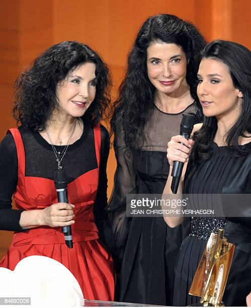 French pianist sisters Katia and Marielle Labeque receive their award of Honour from French TV host Marie Drucker during the 16th Victoires de la...