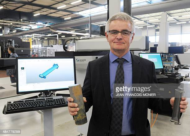 French Pierre Fabre Chairman of SNECMA shows in his left hand a raw TiAi and in his right a TiAi turbine Blade for the new jet engine LEAP of SNECMA...
