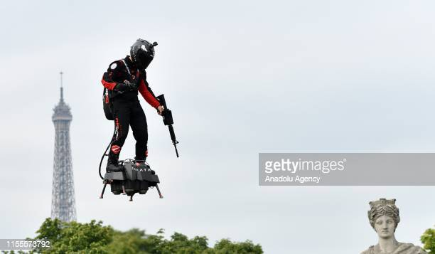 French pilot Franky Zapata performs with flyboard, which the French army is considering using for military purposes during the annual Bastille Day...