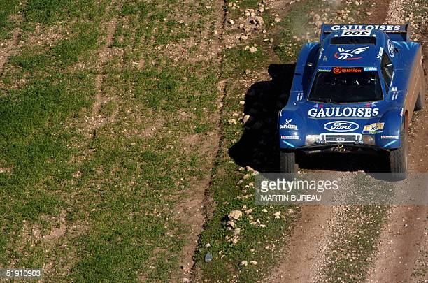 French pilot JeanLouis Schlesser drives his buggy 03 January 2005 during the fourth stage of the 27th Dakar Rally between Rabat and Agadir AFP PHOTO...