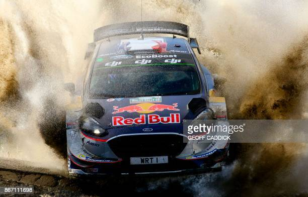TOPSHOT French pilot Sebastien Ogier and co pilot Julein Ingrassia compete in their MSport World Rally Team Ford Fiesta WRC in the Sweet Lamb stage...