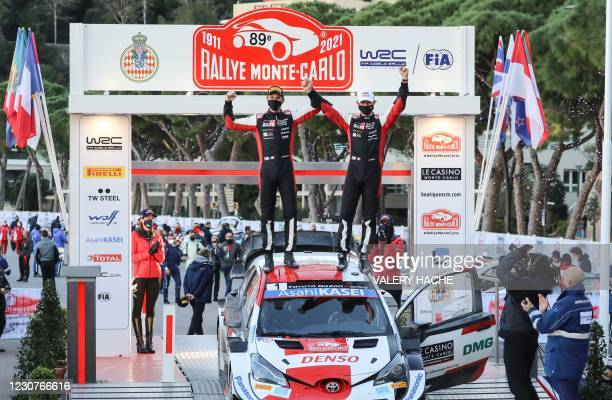 French pilot Sebastien Ogier and co-pilot Julien Ingrassia celebrate their victory during the podium ceremony of the WRC season-opening Monte Carlo...
