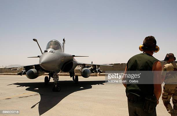 French pilots make final preparations at Kandahar air base before heading off on a mission to support NATO ground troops France is providing aerial...