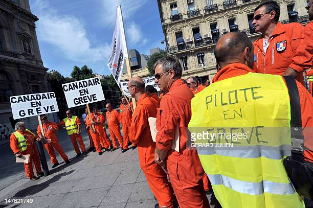 French pilots of water-bombing aircrafts of the Marignane unit, southern France, demonstrate on July 4, 2012 in front of Marseille's prefecture, to...
