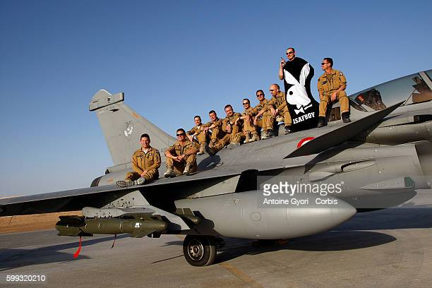 French pilots pose for a group photo at Kandahar air base on a Rafale combat aircraft France redeployed six fighter planes from Tajikistan to the...