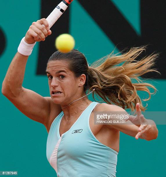French player Amelie Mauresmo hits a return to her Spanish opponent Carla Suarez Navarro during their French tennis Open second round match at Roland...
