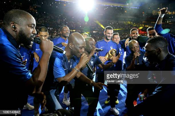 French player and Magic System music group dance with the FIFA World Cup won on July 15 2018 in MoscowRussia in front of their fans after the UEFA...