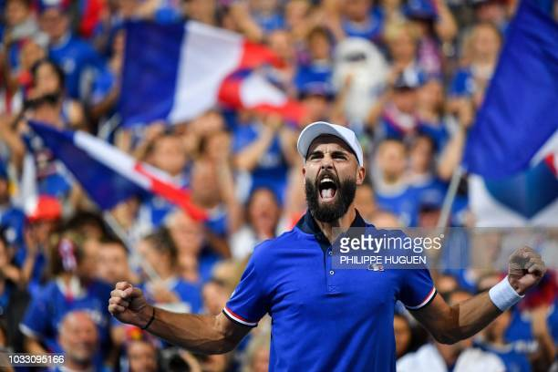 French player Benoit Paire celebrates after winning his tennis match against Spanish player Pablo Carreno Busta during the Davis Cup semifinal...
