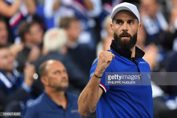 French player Benoit Paire reacts during his tennis match against Spanish player Pablo Carreno Busta during the Davis Cup semi-final between France...